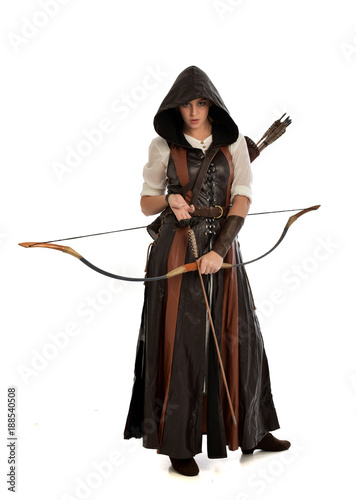 Deurstickers Art Studio full length portrait of girl wearing brown fantasy costume, holding a bow and arrow, on white studio background.