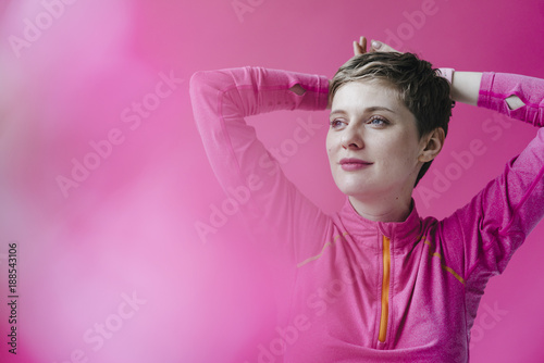 Portrait of woman in pink sportswear