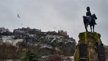 Royal Scots Greys Monument With Edinburgh Castle And Seagull On The Background On The Winter