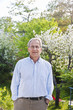 Portrait of mature man in button down shirt standing in garden