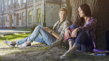 Guy Under Tree Looking At Girl Sitting Next To Him, Love At First Sight Feelings