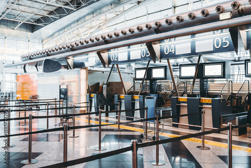 Crédence de cuisine en verre imprimé Aeroport Modern check-in zone of airport: luggage accept terminals with baggage handling belt conveyor systems, numerous empty information LCD screen mockups, indexed check-in desks with digits above