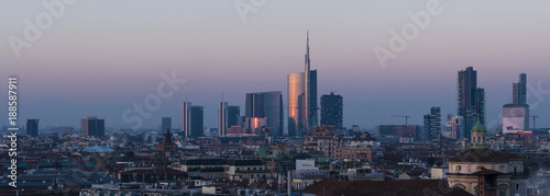 Milan cityscape at sunset, large panoramic view with new skyscrapers of Porta Nuova district.