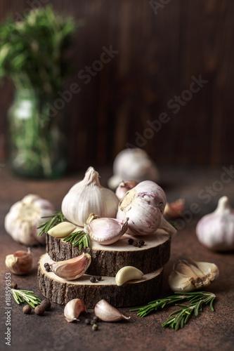 Fresh garlic with rosemary on wooden background. Garlic bulbs