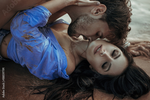 Tuinposter Artist KB Handsome man kissing his sensual woman