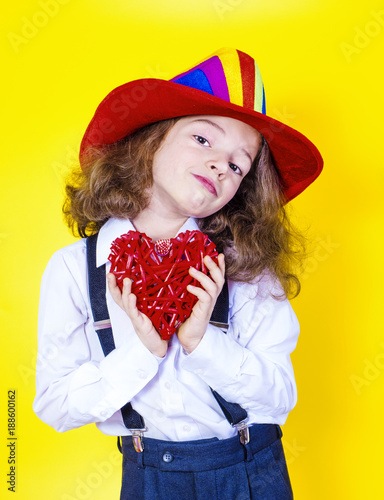 Staande foto Kinderkamer Baby with heart. a cute little boy in a festive American hat holds the heart of love. Valentine's Day