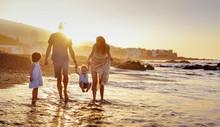 Cheerful Family Having Fun On A Beach, Summer Portrait