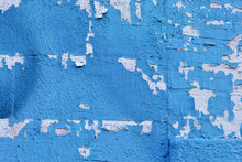 Chipped And Torn Blue Paint On A Concrete Wall