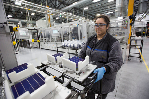 Production operator Diana Correa loads cells into a machine at the ...