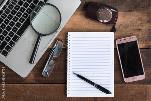 Laptop, Notebook, smartphone, spectacle, camera and magnifying glass