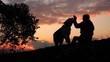 Un uomo e il suo cane giocano al tramonto