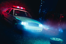 Police Car Arriving Near A Car...