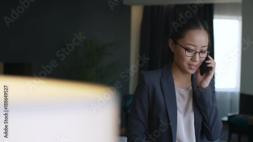Stock video of young asian businesswoman standing with for Apartment japanese movie