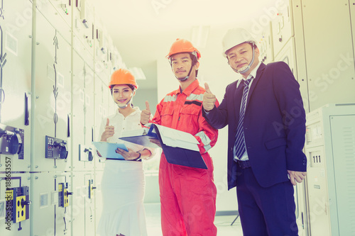 Fototapety, obrazy: engineering team working on checking and maintenance equipment at green energy solar power plant, electrician checking and resolve problem of generate power and check status switchgear.