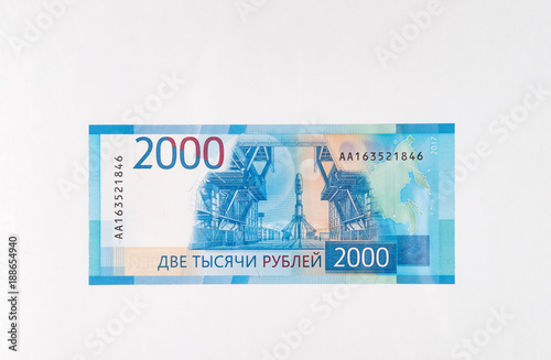 Fotografia  paper money bills of the new Russian rubles Olympic jubilee on white background
