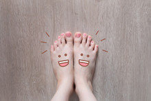 Smiley Face Drawn On Toes. Clo...