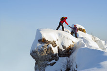 Two Hikers On Top Of The Mount...