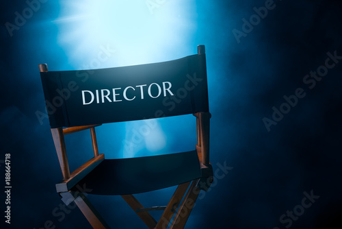 Photo  Back of a vintage director chair on a smokey background , high contrast image