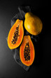 canvas print picture - fresh ripe papaya on a napkin and slate plate kitchen table can be used as background