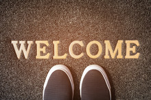 "Black Color Sneakers On Doormat With Inscription ""WELCOME"""
