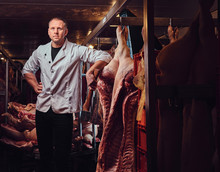 The Butcher In A Meat Factory.