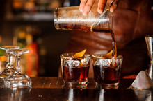 Bartender Pouring Alcoholic Dr...
