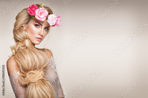 Beautiful woman portrait with long blonde hair and flowers on head Wallpaper Mural