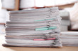 canvas print picture - Stack of old paper documents on table in archive, closeup