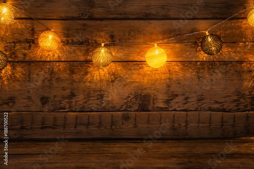 Festive Christmas Lights On Wooden Background