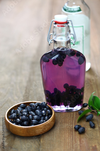 Fototapeta making myrtle liqueur, italian sardinia traditional digestif mirto. obraz