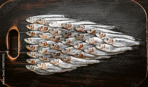 fresh raw fish anchovy and sprat on a wooden surface Canvas Print