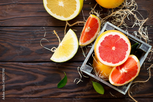 Fresh and juicy red grapefruit and pomelo on a wooden table. Still life, diet and nutrition concept. Flat lay. Top view with copy space.