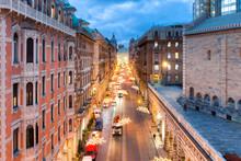 View From The Top Of Viale XX Settembre In Genoa, Piazza De Ferrari In The Background. Christmas Lights Along The Avenue. Christmas Lights Along The Avenue.