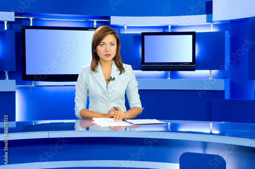 Photo television anchorwoman at TV studio