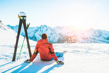 Skier Athlete Sitting In Alpes Mountains On Sunny Day