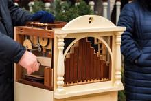 Male Hands On Barrel Organ In ...