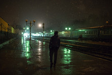 Man On A Train Station At Night