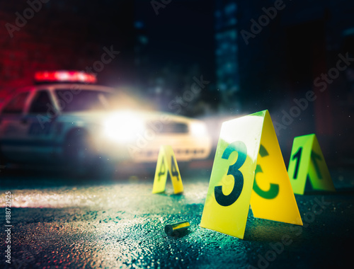 police car at a crime scene with evidence markers, high contrast image Wall mural