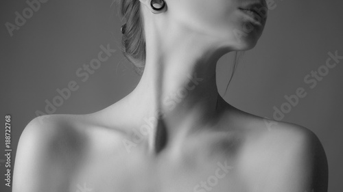 Photo Shoulders and neck of a beautiful woman. Black and white