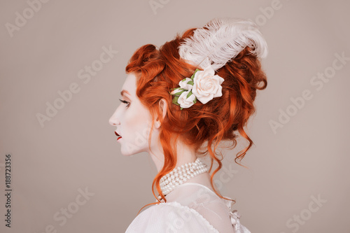 Red Haired Woman In White Dress With Pale Skin On Gray