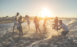 canvas print picture Happy friends having fun inside the ocean at sunset - Young playing with water and laughing together outdoor in summer vacation - Friendship, youth lifestyle, holidays and travel concept