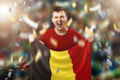 canvas print picture - A Belgian fan, a fan of a man holding the national flag of Belgium in his hands. Soccer fan in the stadium. Mixed media