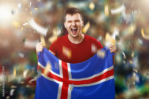Icelandic fan, fan of a man holding the national flag of Iceland in his hands Wallpaper Mural
