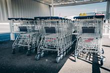 Shopping Carts. Metal Shopping Carts At The Back Of A Store, Shopping Car Row At A Supermarket