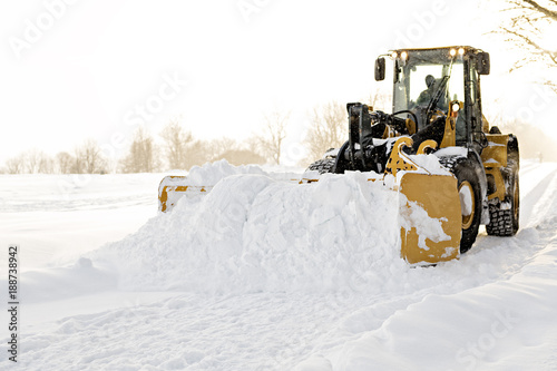 Photo  yellow snow plow cleaning a road