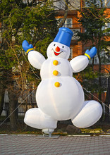 Cheerful Inflatable Snowman. Christmas Decoration On The Street Of Zelenogradsk, The Kaliningrad Region