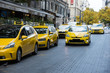 Taxi station, yellow taxi vehicles on the street of the big city