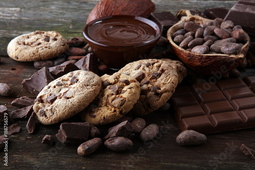 Fotobehang Koekjes Chocolate cookies on wooden table. Chocolate chip cookies shot.