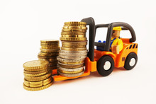 Miniature Forklift With Piles Of Cash Money, Business And Savings Concept