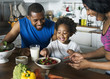 canvas print picture - Black family eating healthy food together
